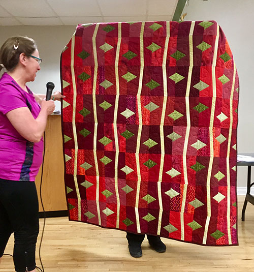 This red and green scrap quilt by _______ was spectacular in its brave use of color.